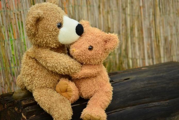 This image has an empty alt attribute; its file name is bear-hug.jpg